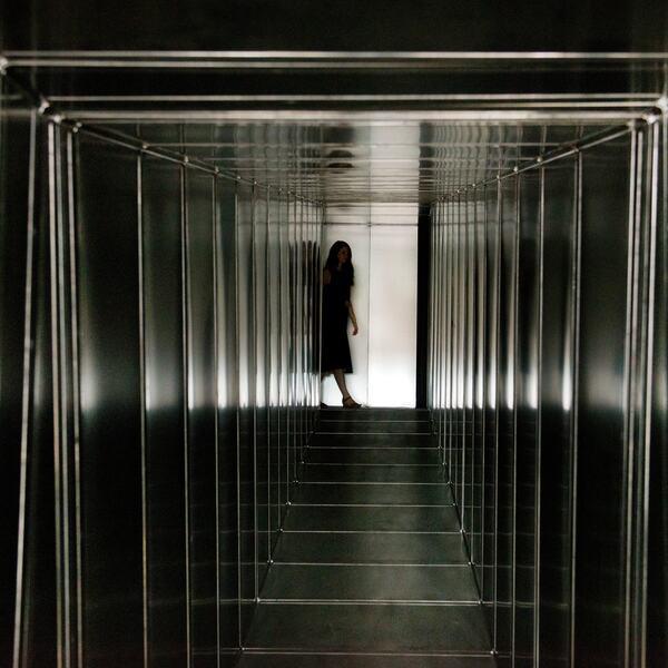 Girl at end of Metal Corridor installation by Carsten Höller in Hayward Gallery