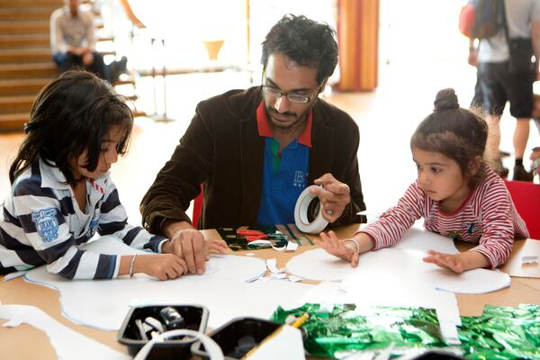 Father and children at a workshop