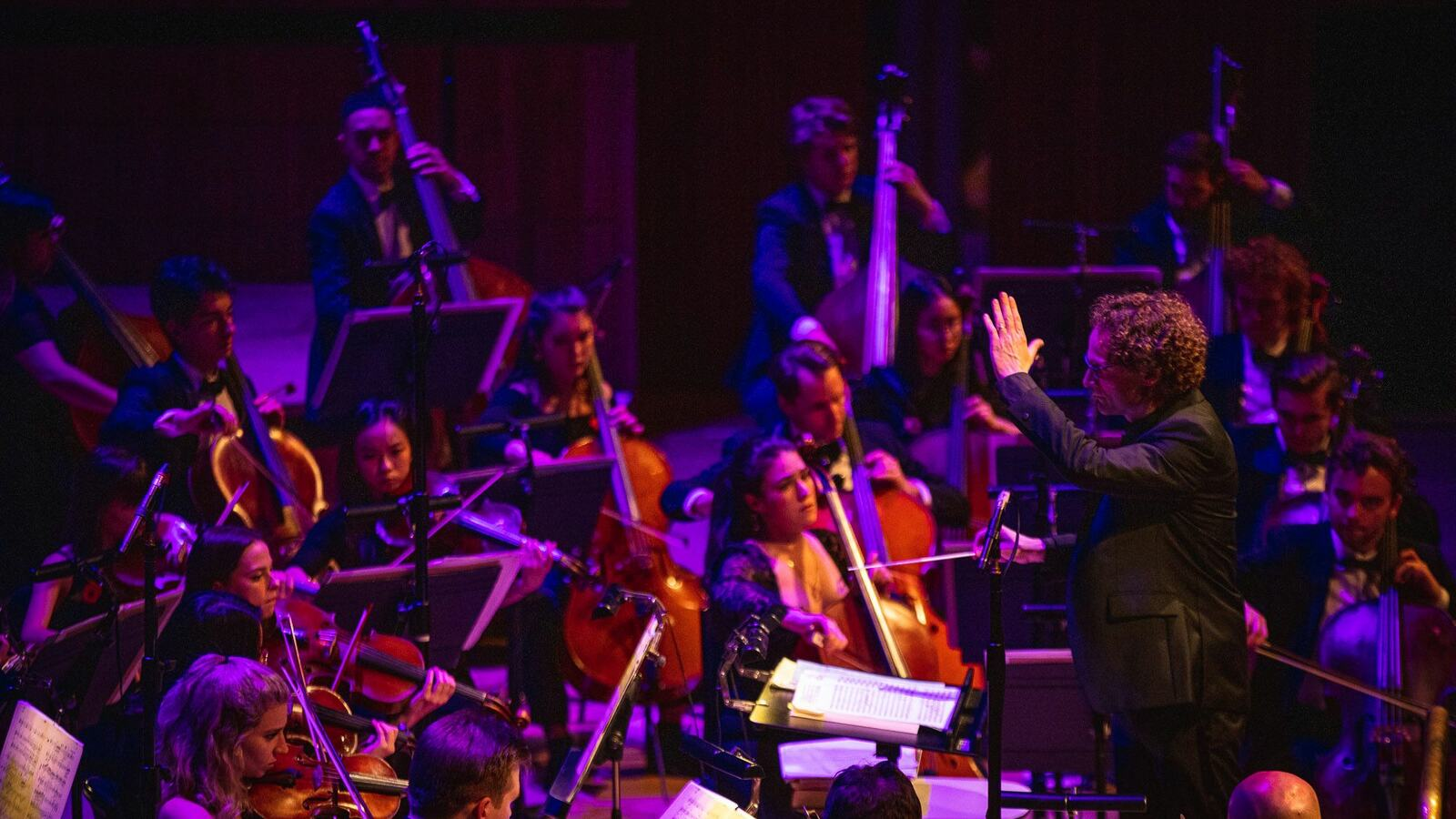 London Philharmonic Orchestra performing on stage