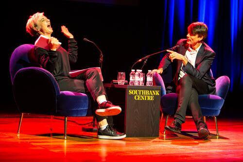 Miranda Sawyer laughs at an anecdote from Brett Anderson during their conversation on stage at Southbank Centre as part of London Literature Festival