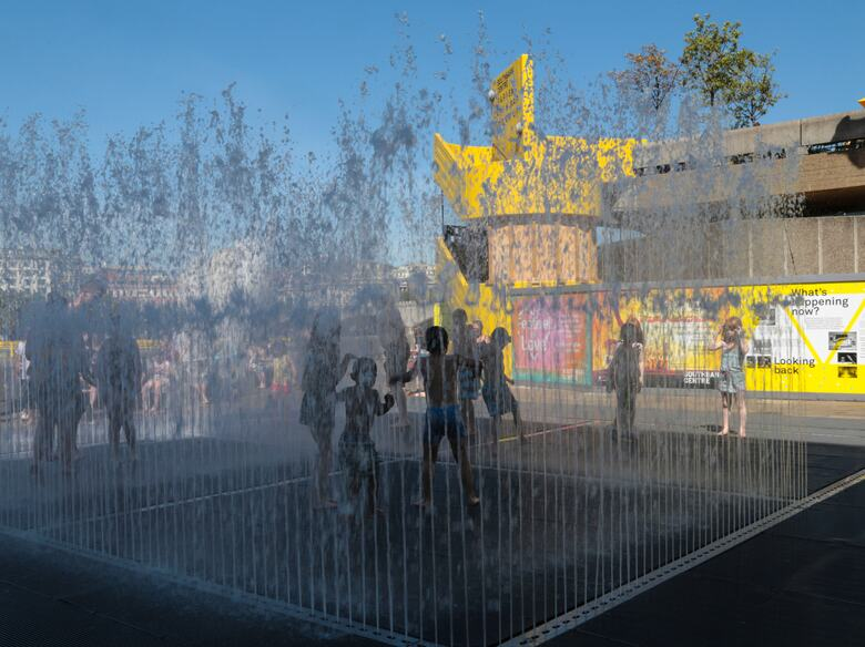 Children Playing in the Jeppe Hein Fountain