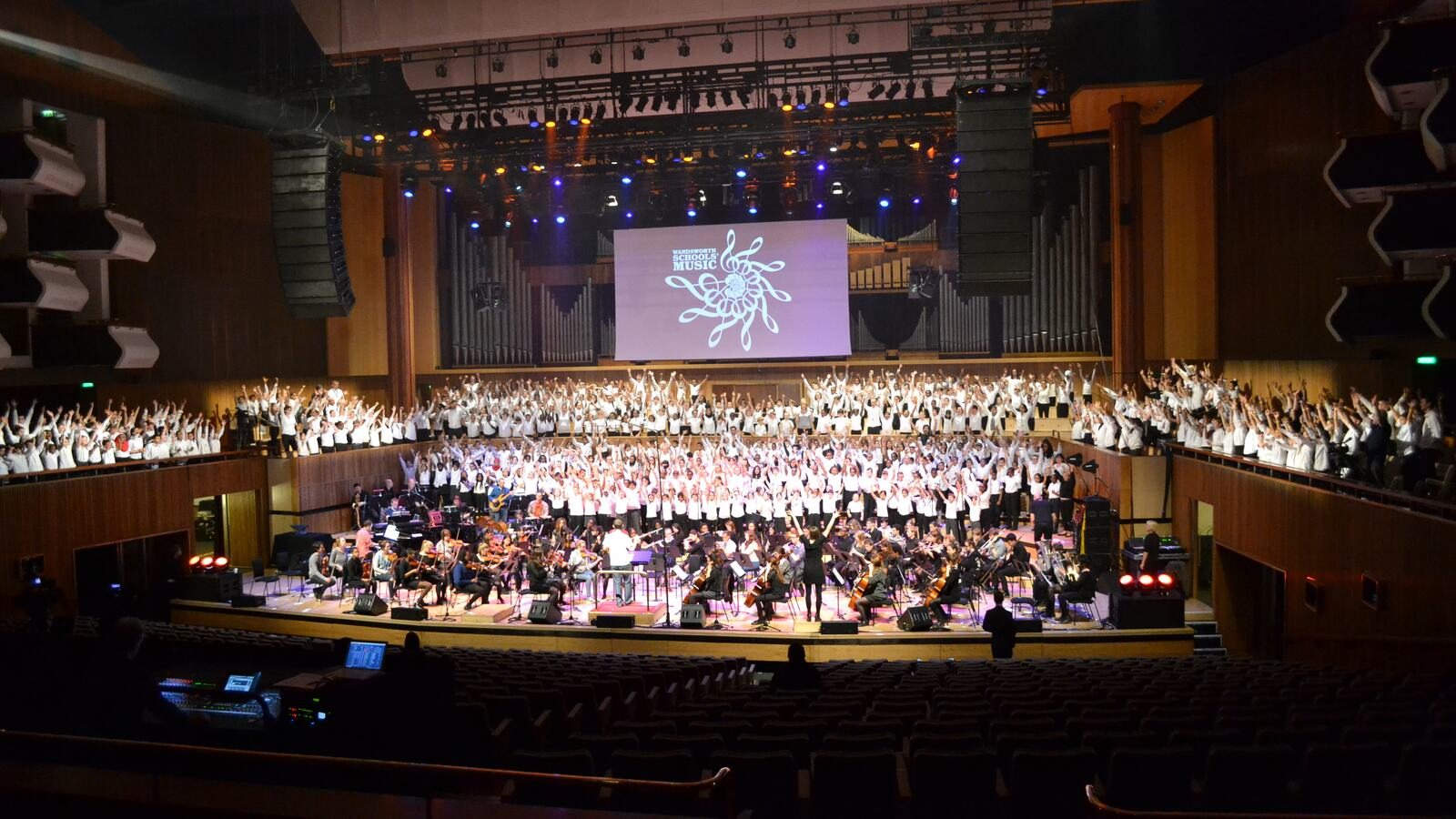 School orchestra and choir performing on stage