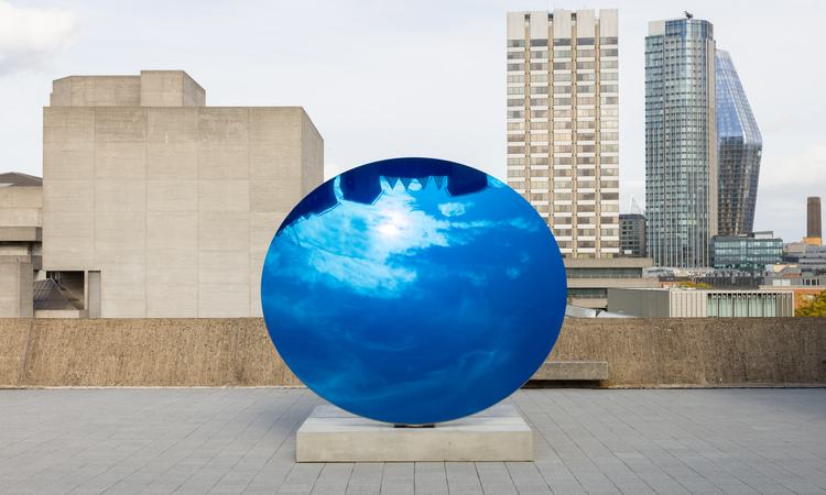 Installation view of Anish Kapoor's Sky Mirror, Blue 2016, at Space Shifters, Hayward Gallery 2018