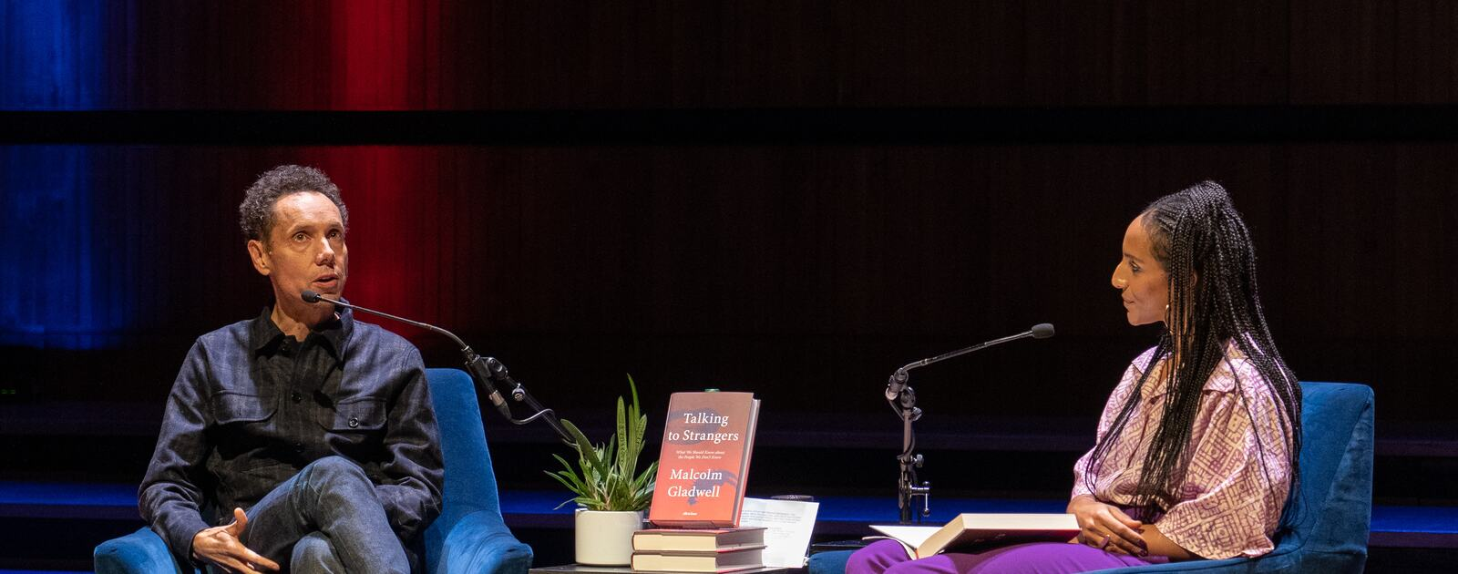 Malcolm Gladwell in conversation with Afua Hirsch on stage at Southbank Centre's Royal Festival Hall