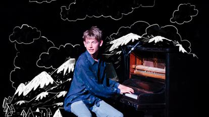 A boy playing a piano