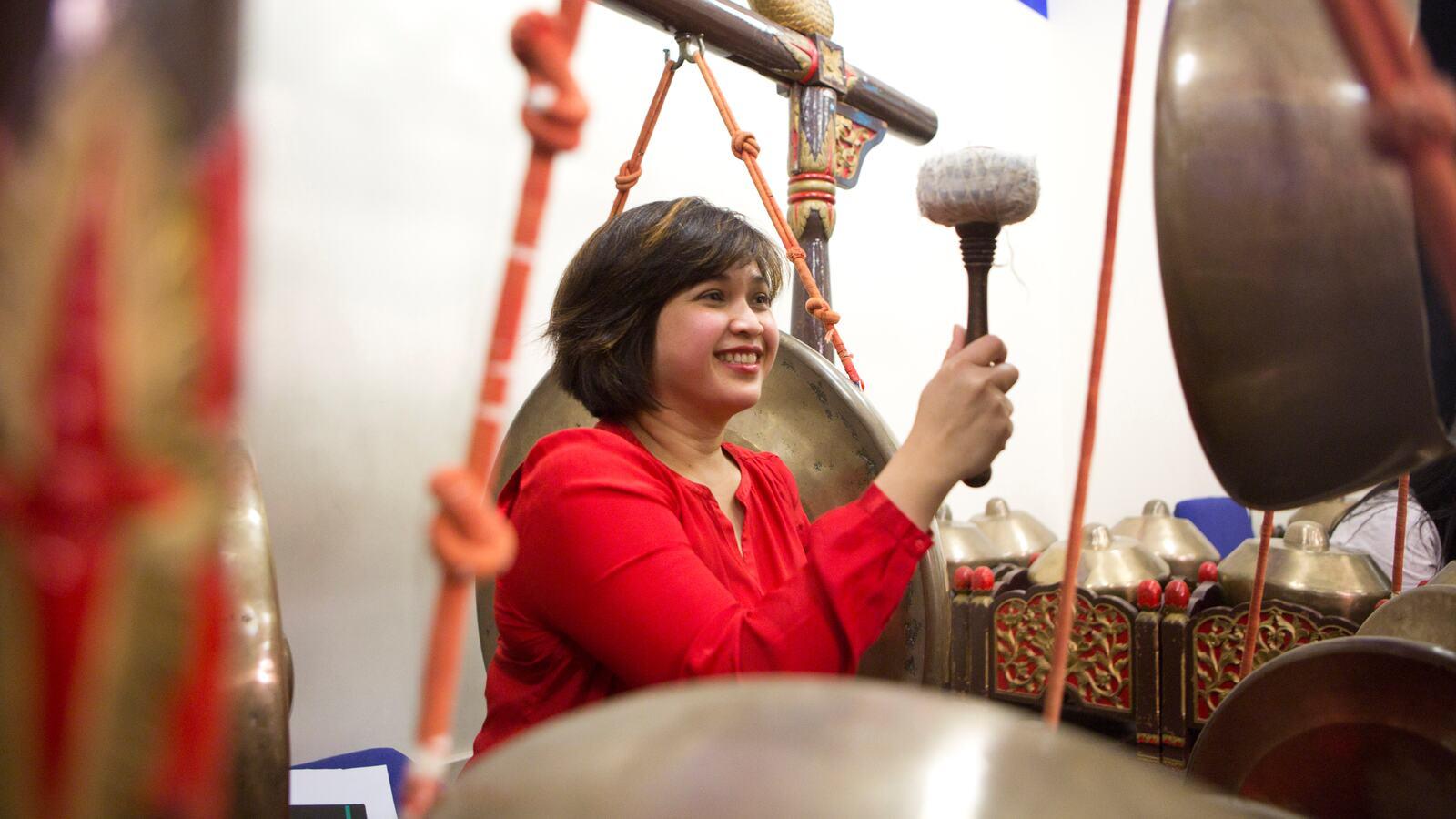 Woman playing Gamelan