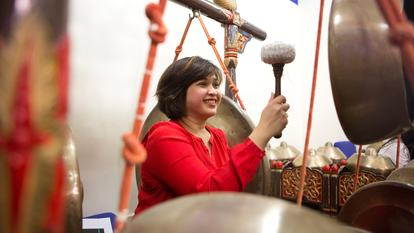 Woman playing Gamelan