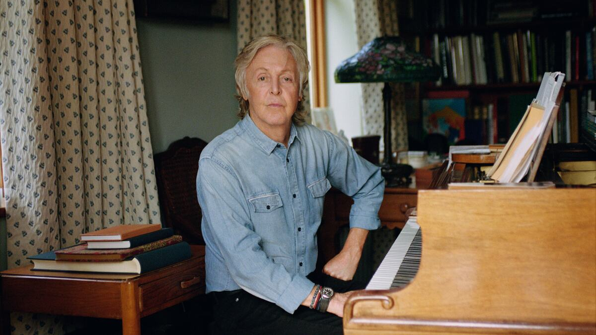 Paul McCartney, artist, pictured by a piano