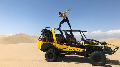 A woman dabbing in a desert