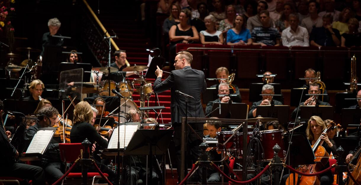 Troy Miller and orchestra performing