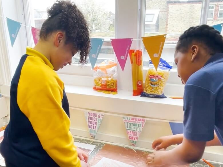 School children. Hayward at Home- Scratch Paining Activity. Still photo taken from a Video.