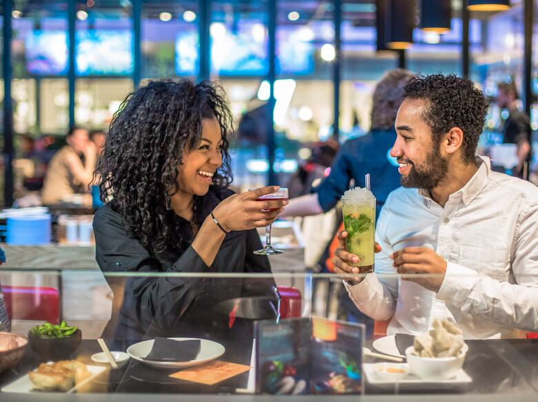 Couple having a cocktail in Ping Pong restaurant at the Southbank Centre