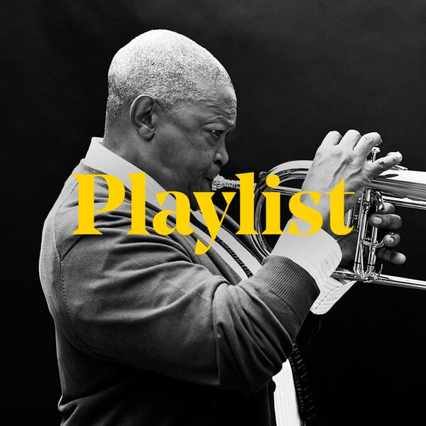 Hugh Masekela plays the trumpet beneath the word 'playlist'