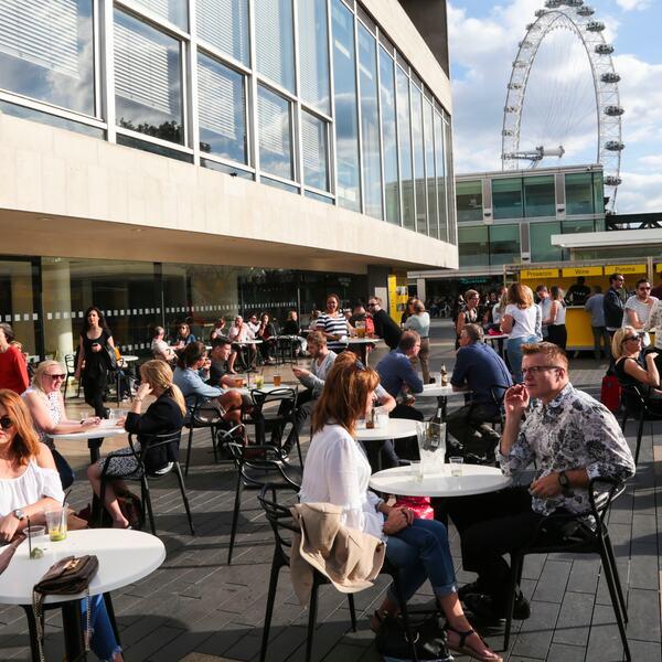 People enjoying the Riverside Terrace