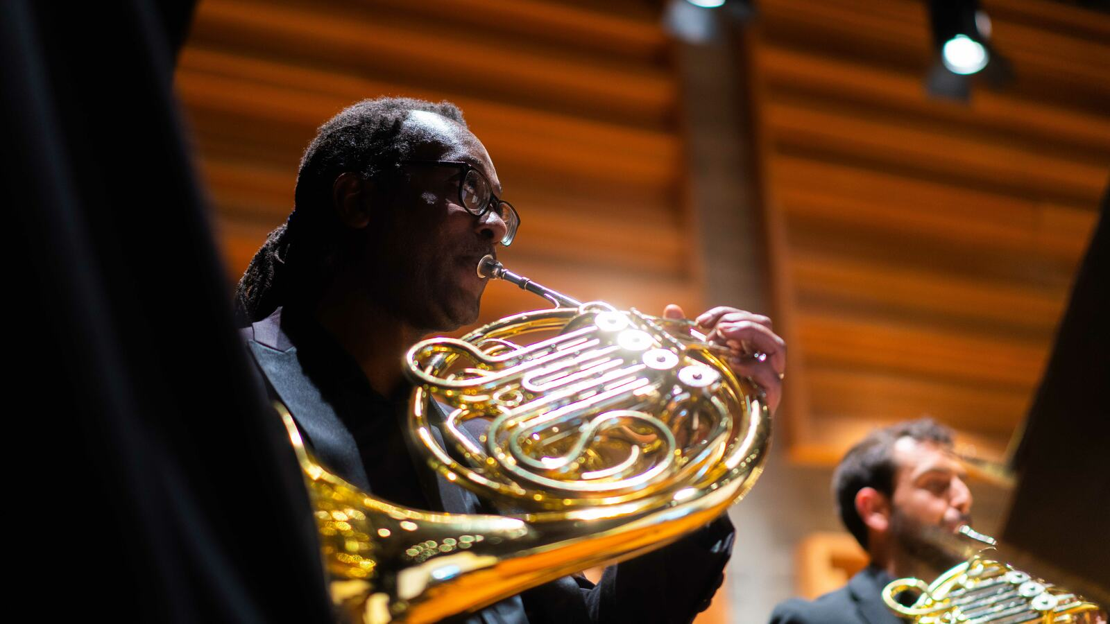 A member of Chineke! playing the French horn