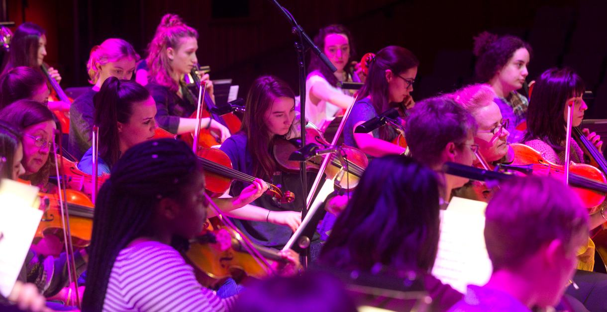 Musicians playing string instruments on stage