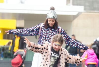 Girl and adult playing on Festival Terrace at Southbank Centre