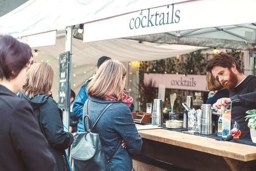 Photo of people looking as a bartender prepares a drink at Honest Folk Cocktail Bar at Southbank Centre