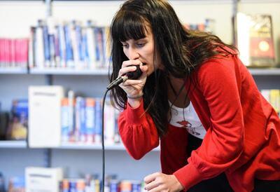 A woman beatboxing