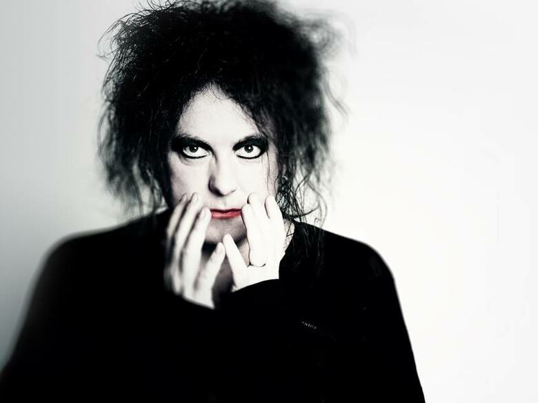 Robert Smith from the band The Cure.