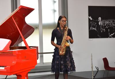 Young musician playing the saxophone