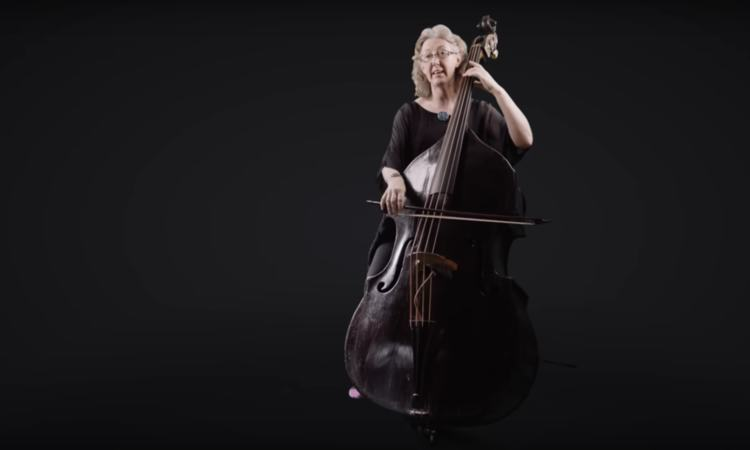 Cecelia Bruggemeyer of the Orchestra of the Age of Enlightenment stands with her double bass