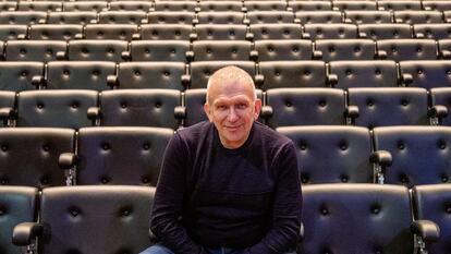 Jean Paul Gaultier sits among the seats on Queen Elizabeth Hall, Southbank Centre