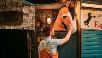 A man with a puppet horse