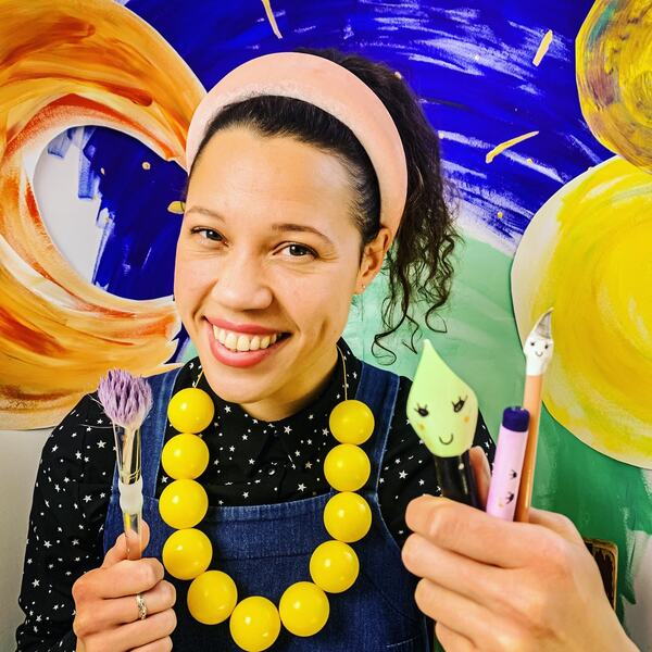 Remmie Milner holding a paint brushes