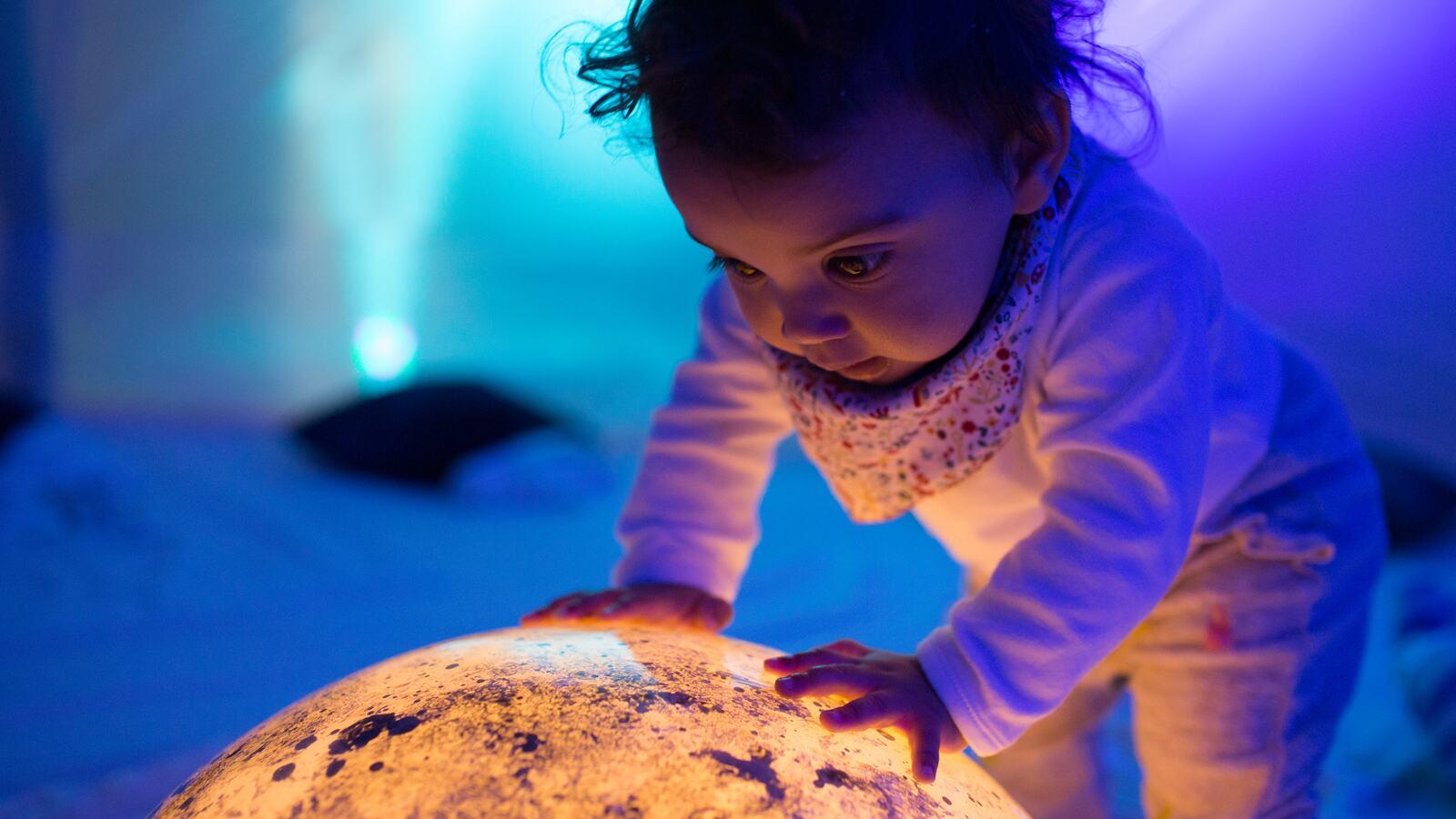 Baby in multi-sensory tent