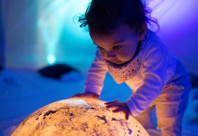 Baby in multi-sensory tent