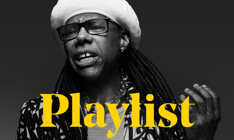 Nile Rodgers mimes guitar behind the word Playlist