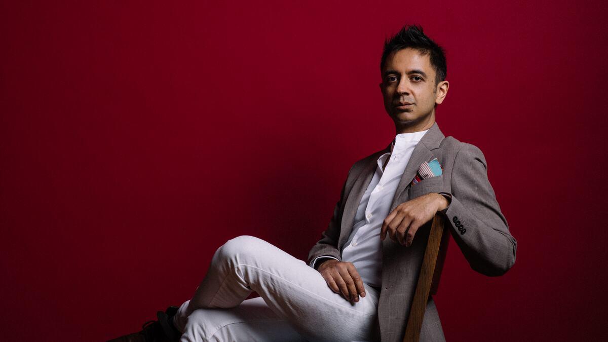 Composer Vijay Iyer portrait sitting on a chair