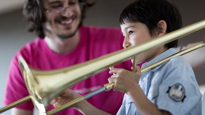 Child playing the trumpet at a workshop