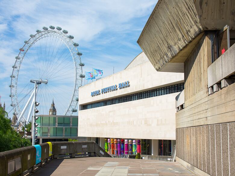 View of the Royal Festival Hall building with the London Eye in the background at the Southbank Centre