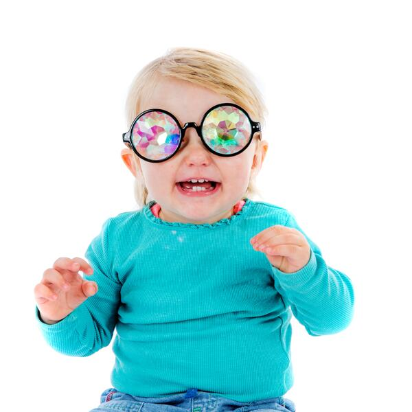 A toddler wearing a kaleidoscope glasees