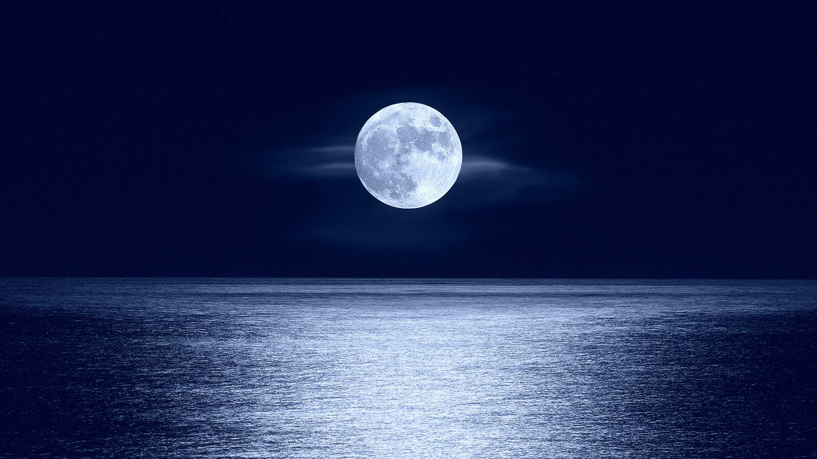 Image of the moon above water