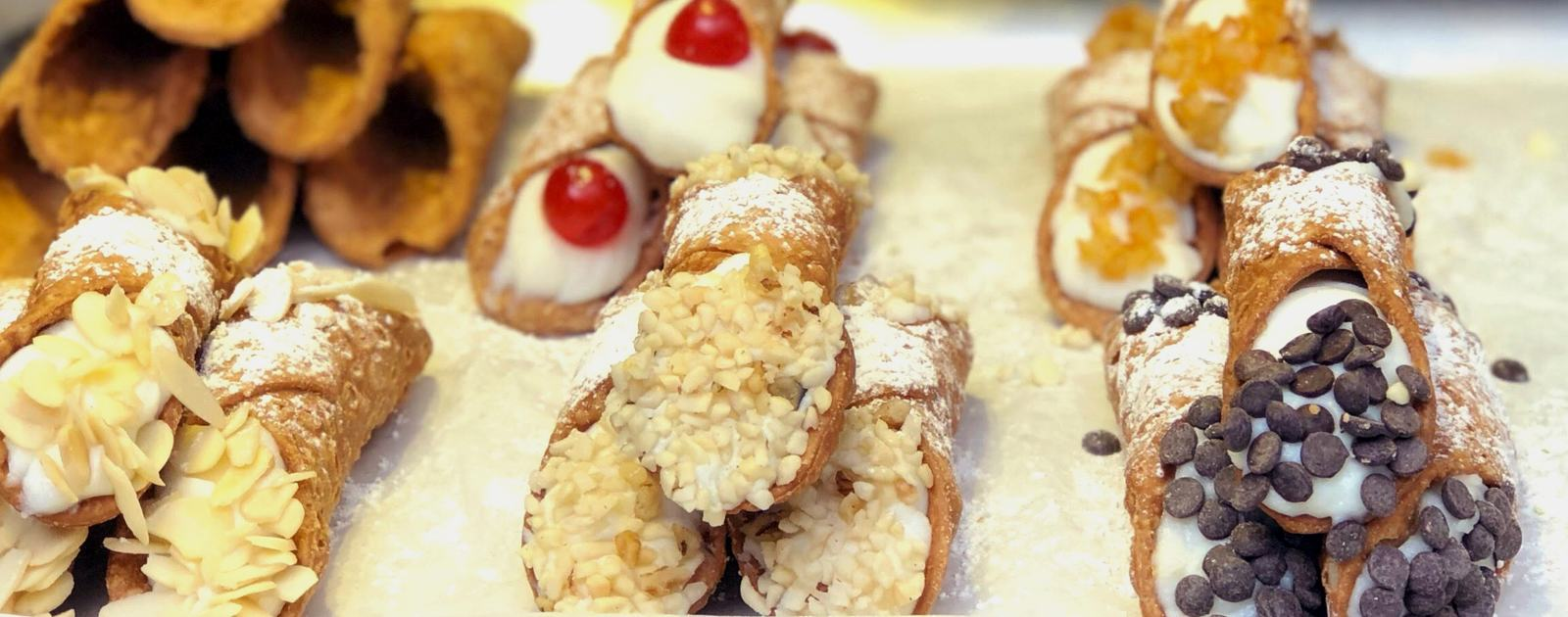 Photo of a tray of various flavoured cannoli made by Bello Gnocco at Southbank Centre Food Market