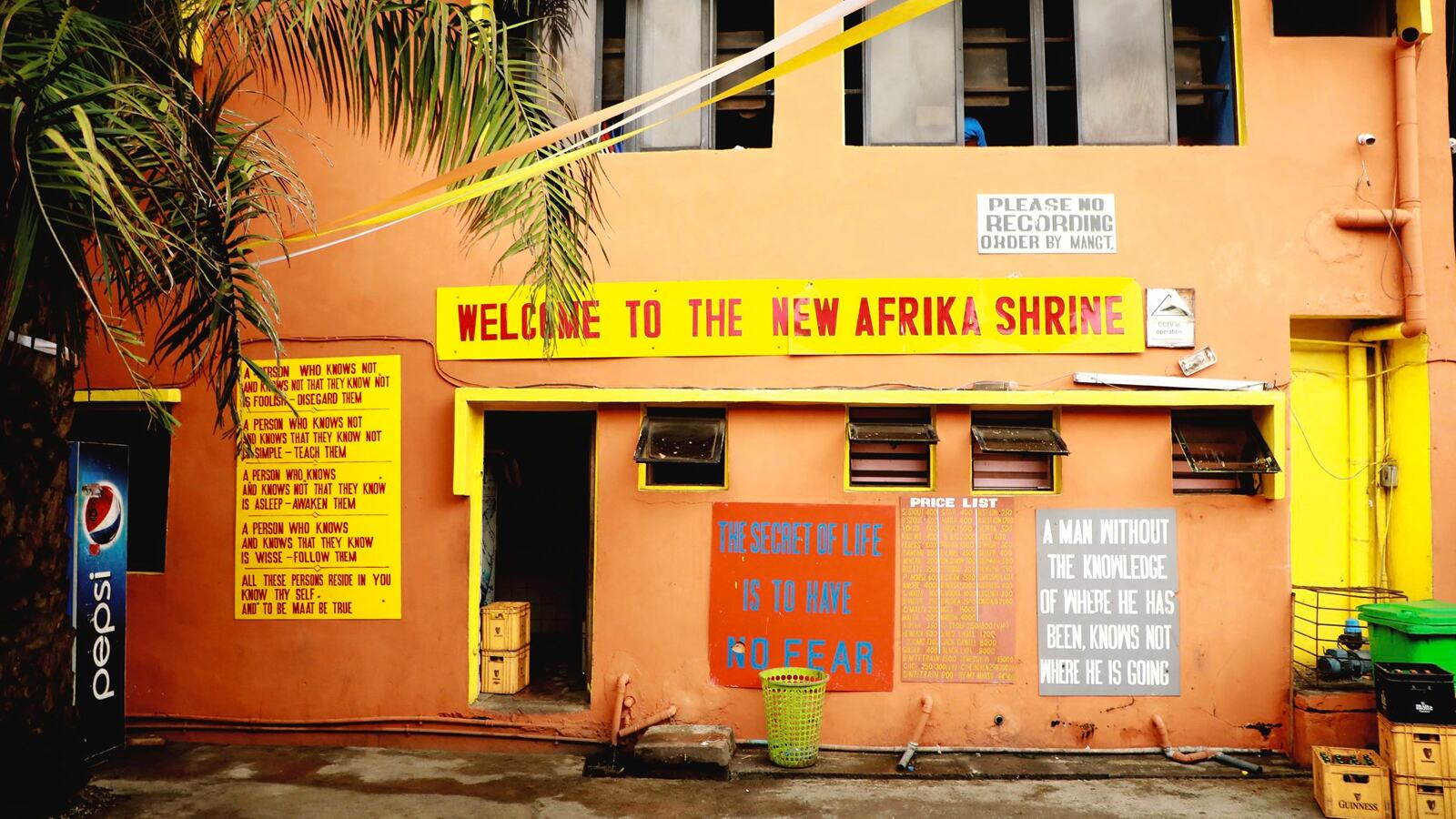 A building with a sign 'Welcome to the New Africa Shrine'
