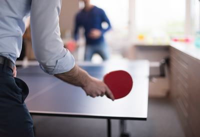 two people playing ping pong tennis