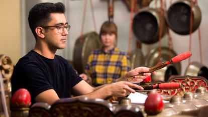 A man playing Gamelan