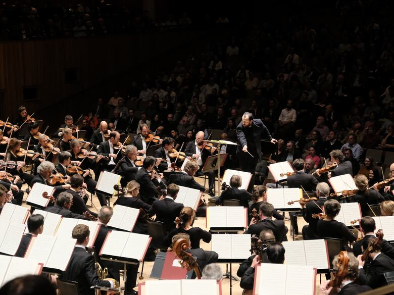 Leipzig Gewandhaus Orchestra performing on stage