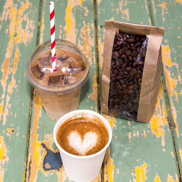 Photo showing a caffe latte, an iced coffee and a bag of coffee beans,  sold by For The Good of the People at Southbank Centre Food Market