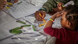 A child colouring at a workshop