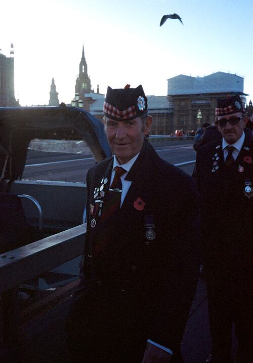 Photograph submitted by William Allen for 'Inspired by Arbus' photography competition run by Southbank Centre with UAL. Photograph depicts two men in traditional Scottish dress, standing on a London bridge.