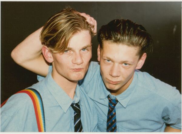 Two young men pose for a photograph at Pride '87 Carnival which took place at South Bank's Jubilee Gardens