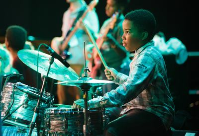 The Jazz Line, young musician playing the drums on stage