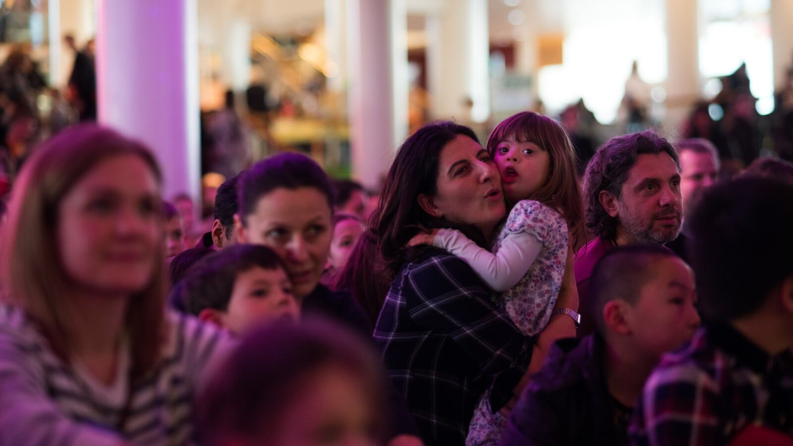 Families watching a performance