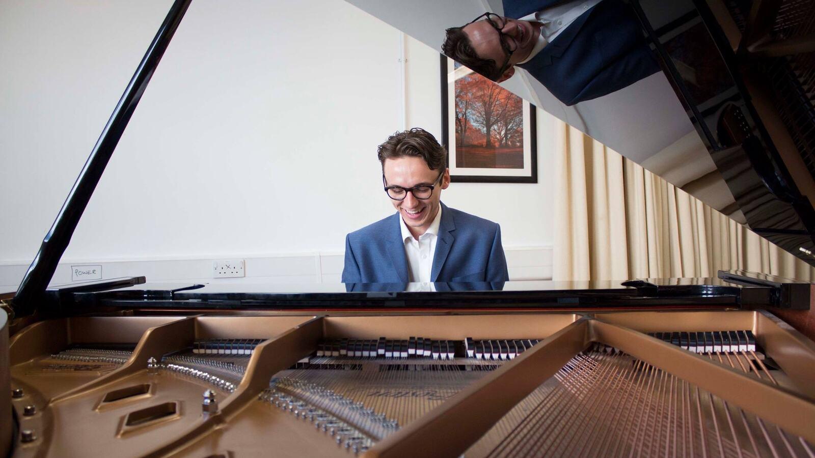 Jack Stephenson-Oliver sat at a grand piano