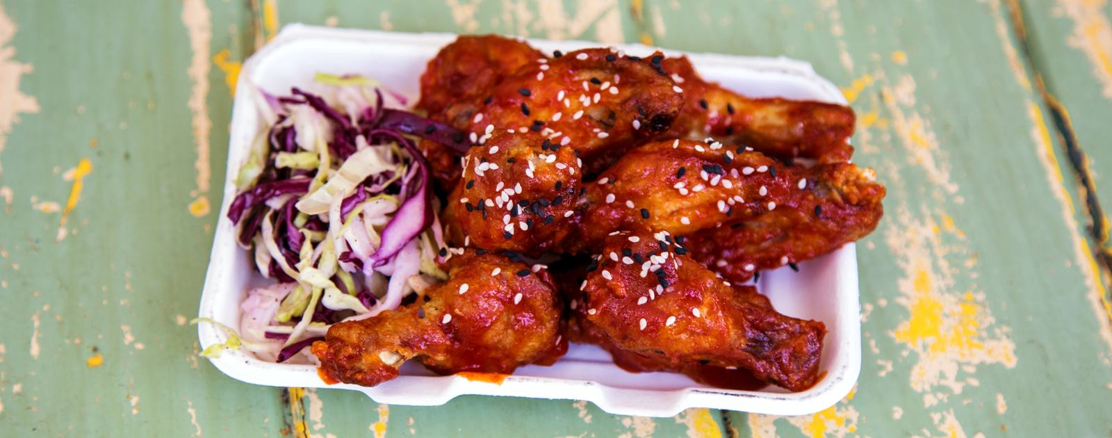Photo of a plate of chicken wings and slaw as served by Spit & Roast at Southbank Centre Food Market